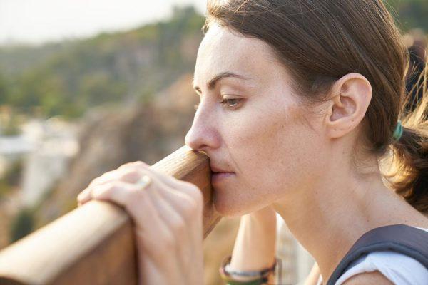 woman thinking against a rail