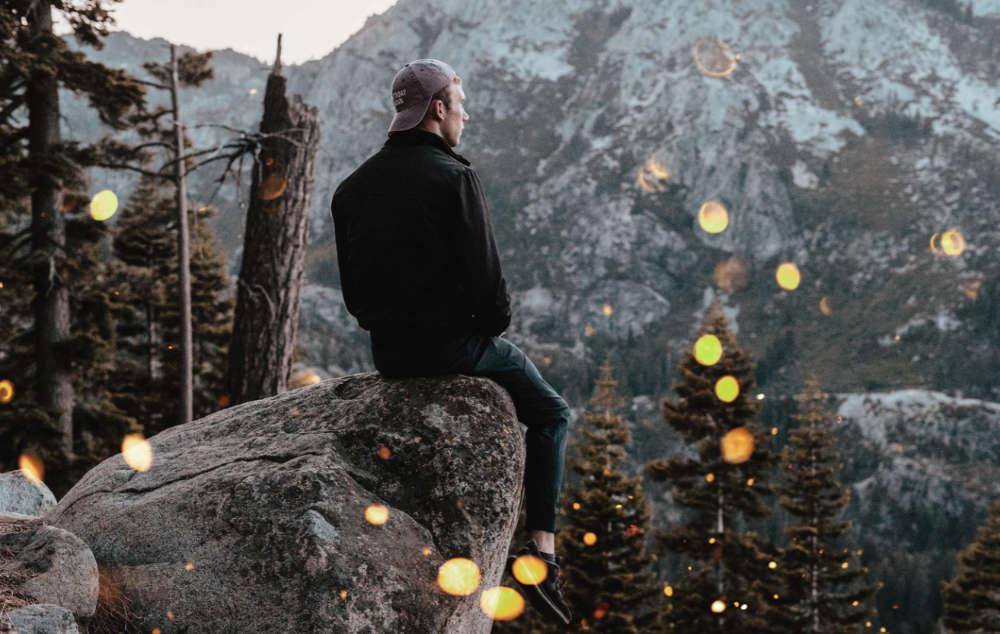 man on rocks thinking