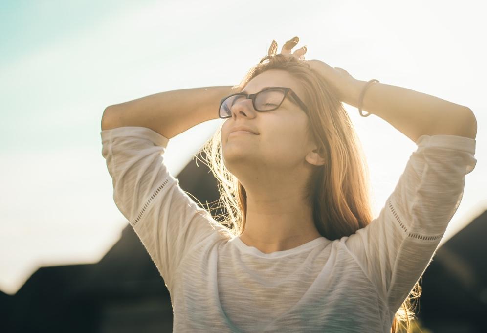 Girl looking into sunshine