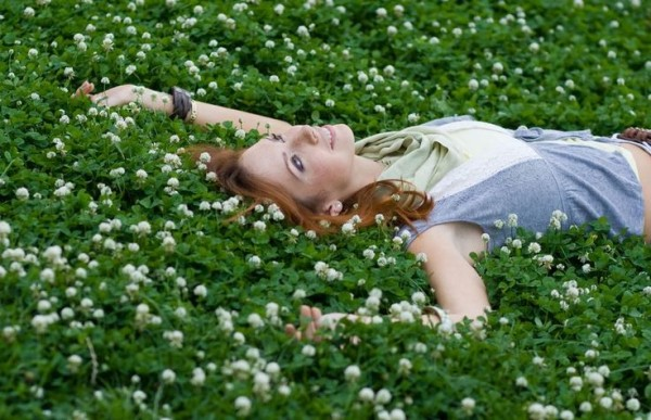 lady laying on grass