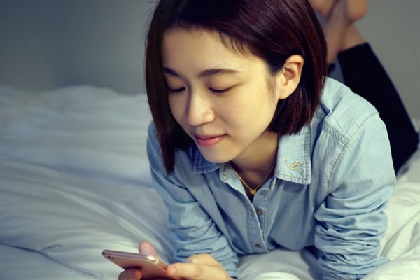 Woman Browsing in mobile phone