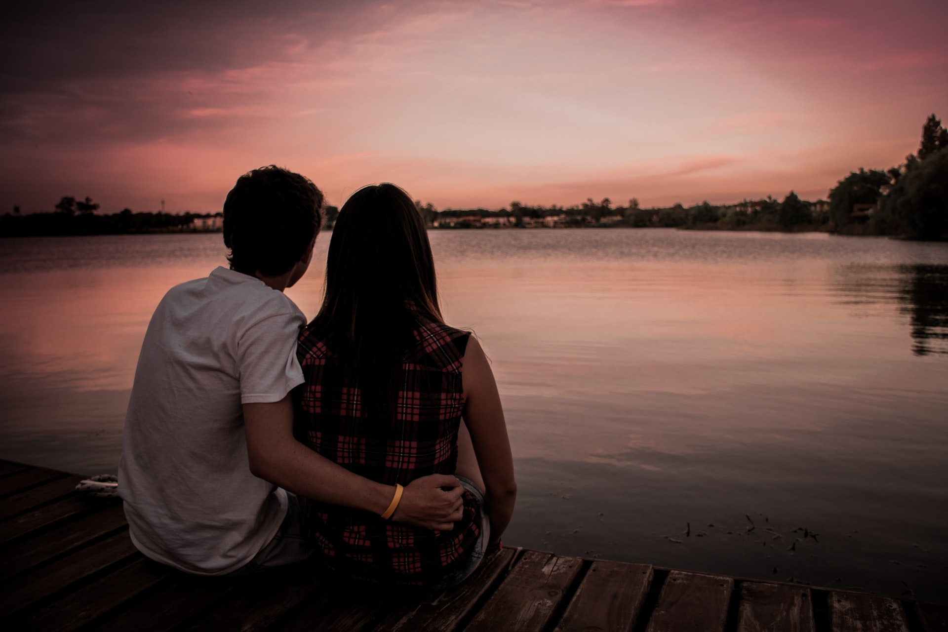 couple sitting on dock thinking about marriage counseling