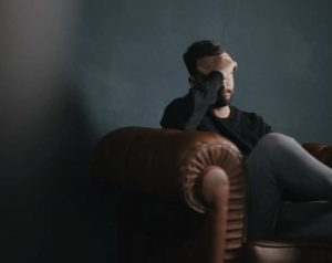 man thinking about couple's therapy at novus mindful life